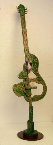 escultura-madera-y-cobre